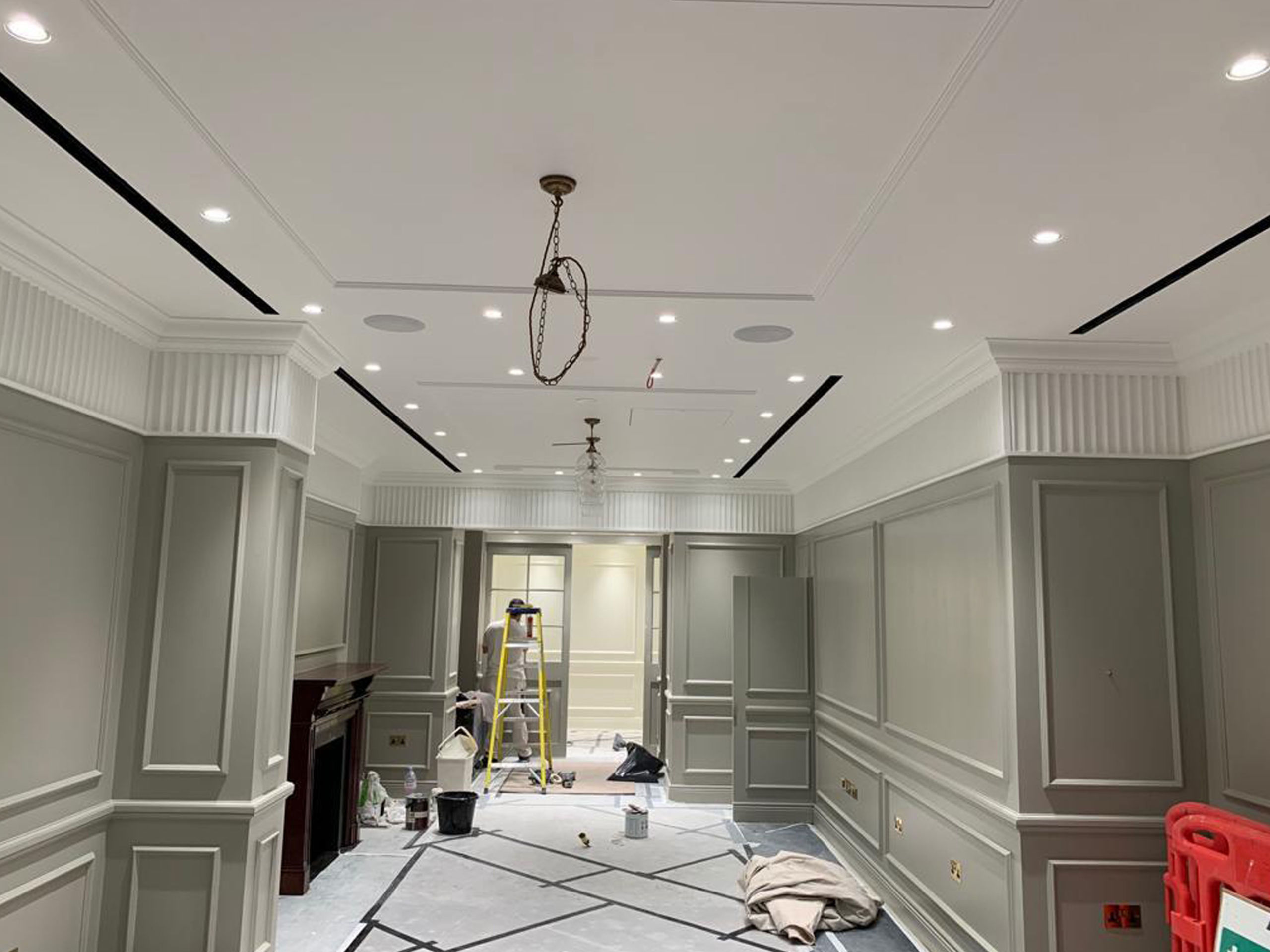 Installation ongoing for larger frieze; wall panels and dado.